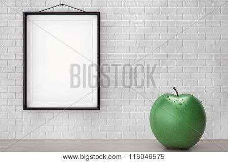 Wet Geen Apple In Front Of Brick Wall With Blank Frame