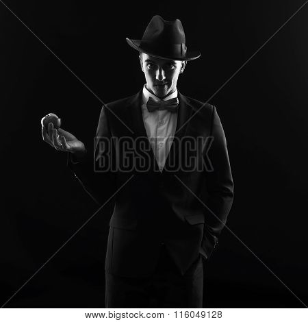 Portrait Of A Man In The Black Hat With Apple In Hand