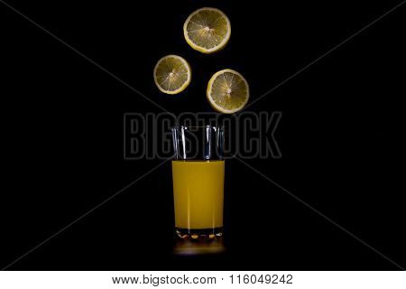 Citrus Fruit Slices Falling Into The Glass