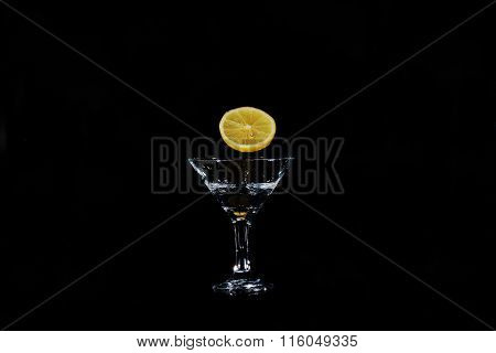 Slice Of Lemon Hangs Over The Beaker