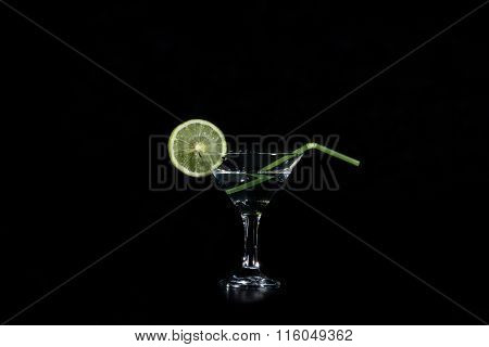 Slice Of Llime Water And A Glass With A Cocktail