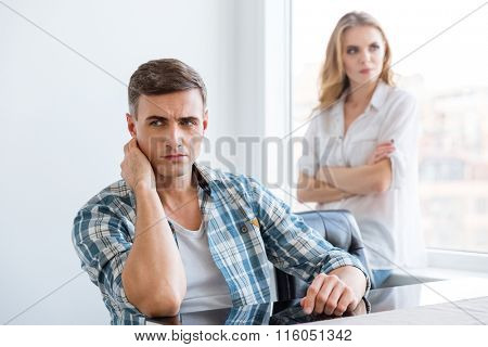 Upset man and woman having difficulties and problems in relationships