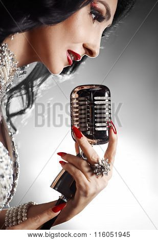 Beautiful Woman Singing A Song With Retro Microphone