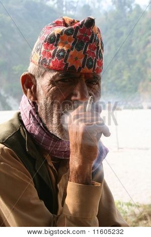 Old Man Smoking Cigaratte.