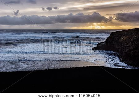 Sunrise by Black sand beach