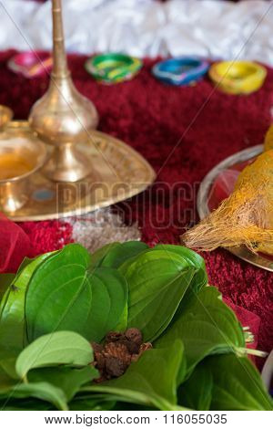 Traditional Indian Hindu religious praying items in ear piercing ceremony for children. Focus on the betel leaves.