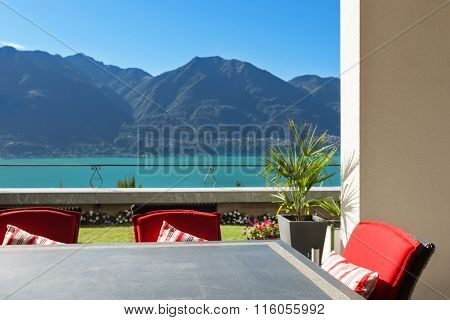 Architecture, nice terrace with table and chairs, lake view