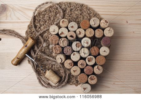Heart Laid Out From Bottle Corks And Corkscrew On Wooden Background