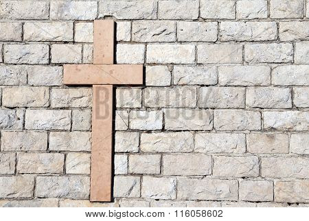 Cross Carved On Marble Attached To The Stone Wall