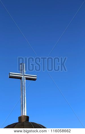 Cross Symbol And Deep Blue Sky