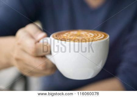Close-up Of Male Hand Holding Coffee