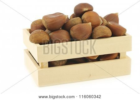 chestnuts in a wooden box on a white background