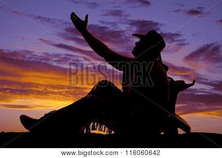 Silhouette Of Cowboy Sit Lean On Saddle Reach Up