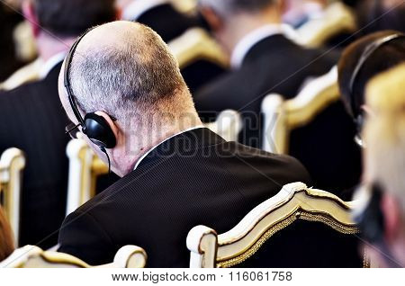 Unrecognizable People Using Headphones