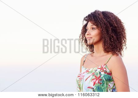 Confident woman looking away outdoors