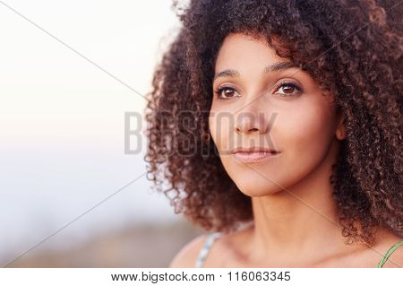 Closeup of a beautiful woman looking into the distance