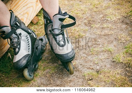 Man Putting On Roller Skates
