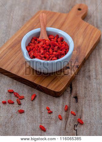 Alternative Health Care And Oriental Food Ingredients Dried Tibetan Goji Berries  On Old Wooden Back