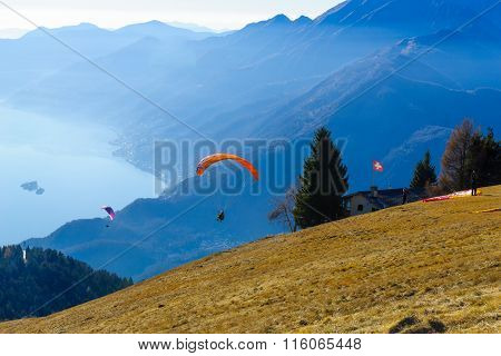 Paragliders On The Cardada-cimetta Mountain Range