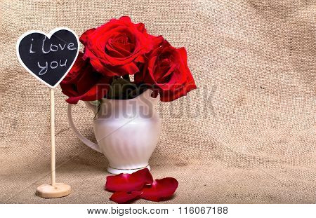 Red Roses And Mini-board With The Text