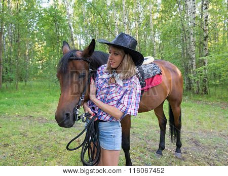 Beautiful Woman  Stroking A Brown Horse