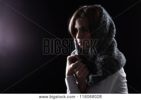 Model With Scarf On Head Looking At Light