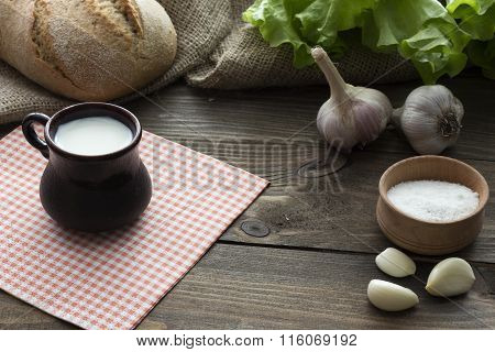 Milk, Bread , Garlic And Lettuce