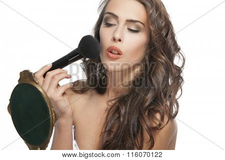 young woman with mirror and blush brush portrait  studio shot
