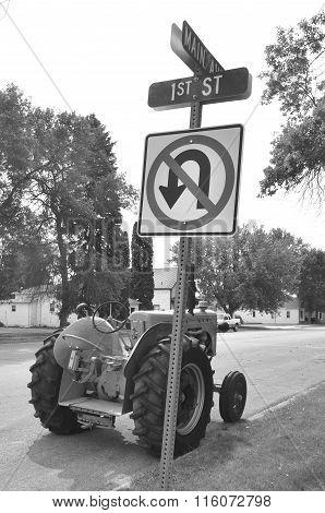 Old tractor parked on Kulm, North Dakota, Main Avenue