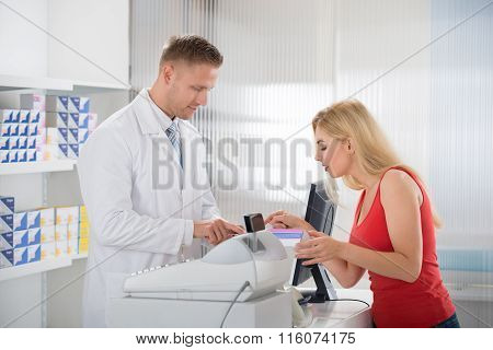 Woman Consulting Pharmacist