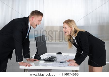 Business People Shouting At Each Other In Office