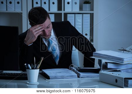 Stressed Accountant Working Late In Office