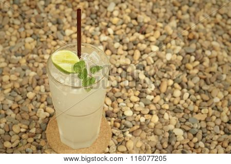 Lemon Juice In A Glass On A Background Of Rock.