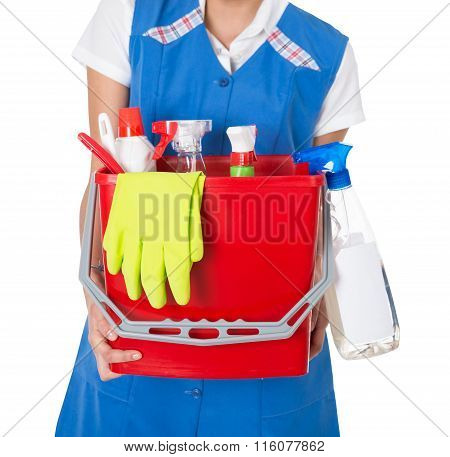 Female Janitor Carrying Bucket With Cleaning Equipment