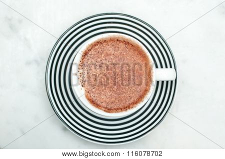 Freshly made cappuccino close up with chocolate sprinkles