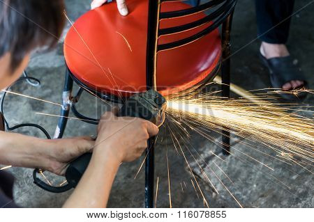 A man working with grinder tool sparks flying