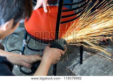 A Man Working With Grinder Tool , Sparks Flying