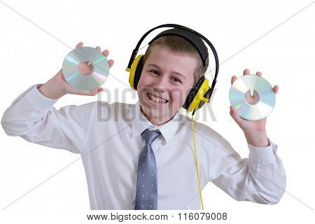Boy in headphones holding two discs