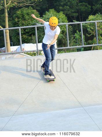 closeup of one skateboarder skateboarding at skatepark