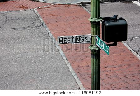 Street Sign - Meeting and Market suggesting a meeting place or an activity