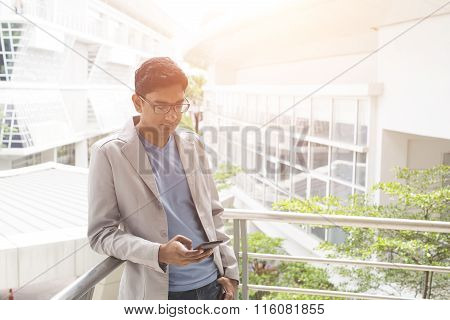 Casual Indian Male Using Phone Outdoor