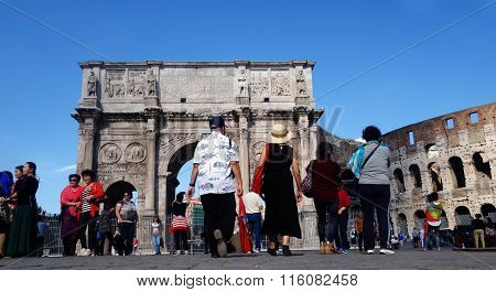 Tourists Visit Italy Via The Roman Forum In Rome,