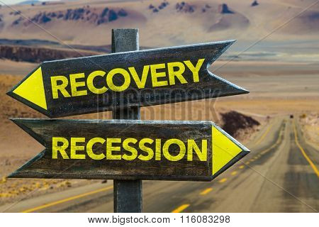 Recovery - Recession signpost in a desert background