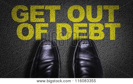 Top View of Business Shoes on the floor with the text: Get Out Of Debt