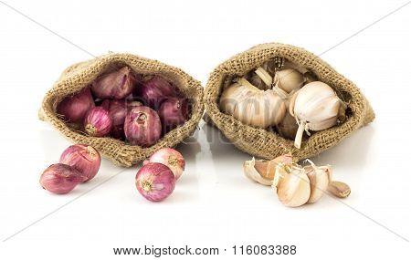 Closeup Of Garlic And Shallot In Brown Bag