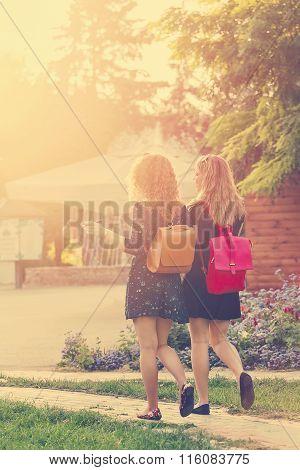 Girlfriends Walking Through Park.