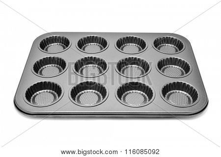 a non stick baking tray with different holes for muffins or cupcakes on a white background