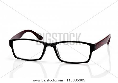 closeup of a pair of plastic and wooden rimmed eyeglasses on a white background