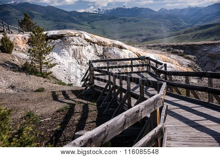 Wooden boardwalks traverse the surreal landscape at Mammoth Hot Springs.