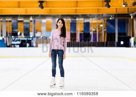 Woman on skating rink